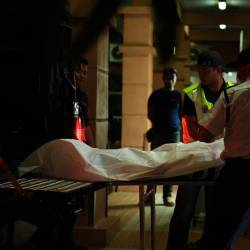 The first body of the four Myanmar victims who were buried in a landslide at a construction site at Jalan Batu Ferringhi, Tanjung Bungah, arrived at the Forensic Medicine Department at 2.35am on June 26, 2019. for a post-mortem. - Bernama