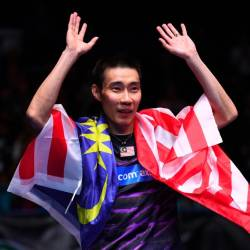 In this file photo taken on March 12, 2017, Datuk Lee Chong Wei celebrates his victory over China's Lin Dan in their All England Open Badminton Championships men's singles final match in Birmingham, central England. - AFP