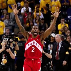 Kawhi Leonard #2 of the Toronto Raptors celebrates his teams win over the Golden State Warriors in Game Six to win the 2019 NBA Finals at ORACLE Arena on June 13, 2019 in Oakland, California. — AFP