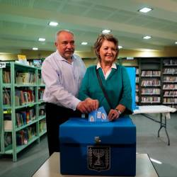 Avigdor Lieberman, leader of Yisrael Beitenu party, casts his ballot in Israel's parliamentary election, along with his wife Ella at a polling station in the Israeli settlement of Nokdim in the occupied West Bank Sept 17, 2019. — Reuters
