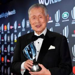 This file photo taken on Nov 25, 2018 shows the Vernon Pugh Award for Distinguished Service winner, former Japanese prime minister Yoshiro Mori, posing with his trophy during the World Rugby Awards ceremony in Monaco. — AFP