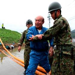Japan Self-Defense Forces evacuate a man from a flooded area during search and rescue operations in the aftermath of Typhoon Hagibis in Marumori, Miyagi prefecture on Oct 14, 2019. — AFP