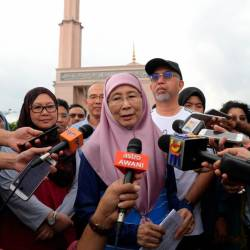 Deputy Prime Minister Datuk Seri Dr Wan Azizah Wan Ismail speaks to reporters after attending the 'Brisk Walk' programme at the Putra Mosque grounds, Putrajaya on June 21, 2019. - Bernama