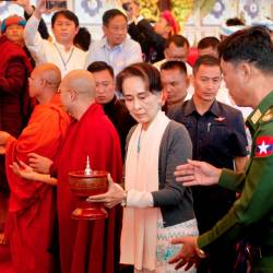This picture taken on Nov 20, shows Myanmar's State Counselor Aung San Suu Kyi (C) and and Home Affairs Minister Lieutenant General Kyaw Swe (R) attending the opening ceremony of a new pagoda at Kyauktalonegyi city on the outskirts of Taung Gyi, Shan State. — AFP