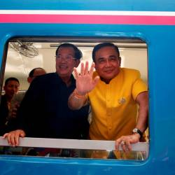 Thailand Prime Minister Prayuth Chan-ocha and his Cambodian counterpart Hun Sen ride a train during a ceremony to re-establish a rail link between the two countries at the friendship bridge at the Ban Nong Ian-Stung Bot border April 22, 2019. — Reuters