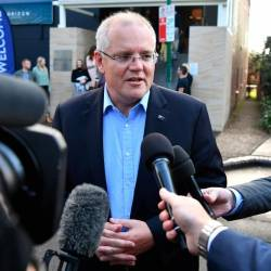 Australian Prime Minister Scott Morrison speaks to the media as he arrives at the Horizon Church in Sutherland in Sydney, Australia, May 19, 2019. - Reuters