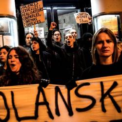 Demonstrators hold banners during a protest against French-Polish film director Roman Polanski outside the Champo cinema hall in Paris on Nov 12. — AFP