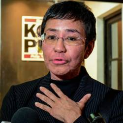 Maria Ressa, co-founder and CEO of the Philippines-based news website Rappler, speaks to members of the media as she leaves after a hearing in a court in Manila on Dec 16. — AFP