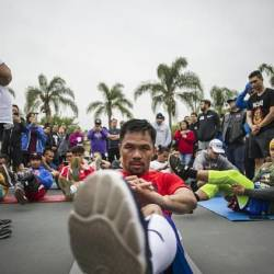 Filipino boxer Manny Pacquiao trains in the morning with fans and friends at Pan Pacific Park in Los Angeles ahead of his July 20 fight with Keith Thurman. — AFP