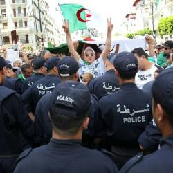 Algerian protesters face riot police during a demonstration in the capital Algiers in June. — AFP