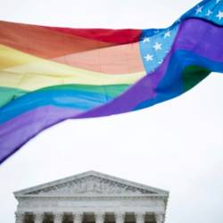 A rainbow flag flies outside the US Supreme Court on December 5, 2017. — AFP