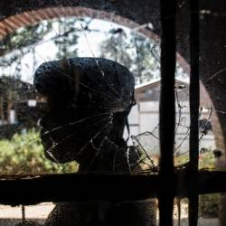 A bullet-shattered window at an Ebola treatment centre in Butembo after it came under attack on March 9. A policeman was killed and a health worker wounded. — AFP