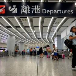 A passenger walks at the departure hall of Hong Kong's West Kowloon Terminus, which connects the city to mainland China by rail, on August 20, 2019. — AFP