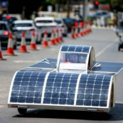 A Cypriot competitor steers his solar car during the Cyprus Institute's solar car challenge in Nicosia on June 23, 2019. — AFP