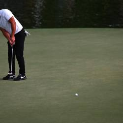 Brooks Koepka putts on the 15th hole during the second round of the Tour Championship golf tournament at East Lake Golf Club. - AFP