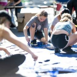 Nora Gell (center), 14, paints cardboard waves in Brooklyn on September 15, 2019 for the climate strike protests planned for September 20. — AFP