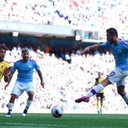 Manchester City's Portuguese midfielder Bernardo Silva (R) scores the team's seventh goal during the English Premier League football match between Manchester City and Watford at the Etihad Stadium in Manchester, England, on Sept 21, 2019. - AFP