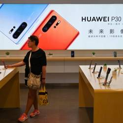 People browse for items in a Huawei store in Shanghai on May 24, 2019. - AFP
