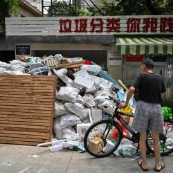 Every day, Shanghai produces around 26,000 tonnes of garbage – equal in weight to the Statue of Liberty. — AFP