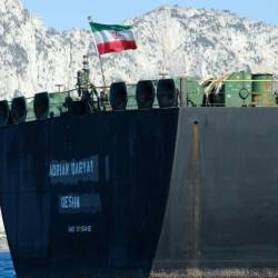 An Iranian flag flutters on board the Adrian Darya oil tanker, formerly known as Grace 1, off the coast of Gibraltar on August 18, 2019 before it set sail. — AFP