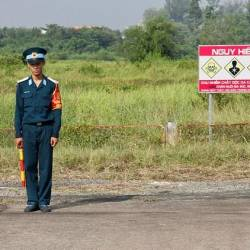 A Vietnamese soldier stands next to a sign warning of toxic hazard at Bien Hoa air base, on the outskirts of Ho Chi Minh City. — AFP