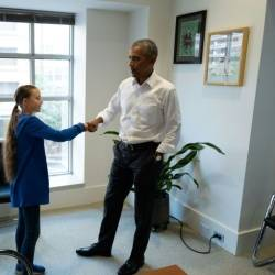 Former US president Barack Obama (R) met with climate activist Greta Thunberg in Washington. — AFP