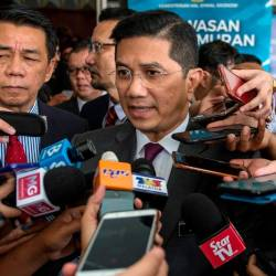 PKR deputy president Mohamed Azmin Ali speaks to the media after his speech at Institut Tadbiran Awam Negara (Intan) Ministerial Forum Series 2019 at Bukit Kiara. - Bernama