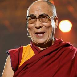 The Dalai Lama speaks at a concert at Syracuse University in 2012. — AFP