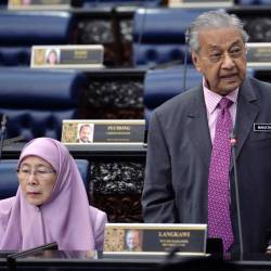 Prime Minister Tun Dr Mahathir Mohamad answers questions during today's parliamentary sitting. - Bernama