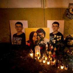 A picture taken in Bratislava on February 20, 2019 shows candles beside portraits of Slovakian journalist Jan Kuciak and his fiancee Martina Kusnirova who were found shot dead at the couple's home near Bratislava. — AFP