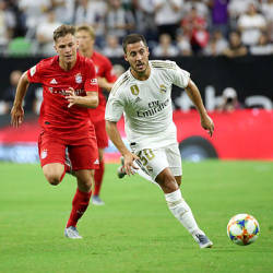 Real Madrid forward Eden Hazard (50) controls the ball as Bayern Munich defender Joshua Kimmich (32) chases during the first half of the International Champions Cup soccer series at NRG Stadium, Houston, Texas yesterday.