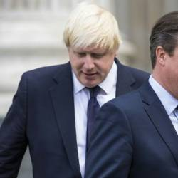 Former prime minister David Cameron, pictured in 2015 with then-London Mayor Boris Johnson, refused to apologise for calling the Brexit referendum. — AFP