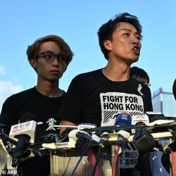 Hong Kong activist Jimmy Sham likened chief executive Carrie Lam's offer to a 'knife' that had been plunged into the city. — AFP