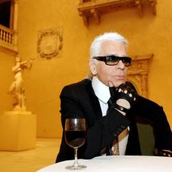 In this file photo taken on May 2, 2005 German fashion designer and creative director of Chanel, Karl Lagerfeld listens to a question during an interview in a room housing the Patio from the Castle of Velez Blanco from Spain at a press preview of Chanel, an exhibition of the history of the fashion House of Chanel at the Metropolitan Museum of Art in New York. — AFP
