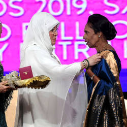 The Raja Permaisuri Agong Tunku Hajah Azizah Aminah Maimunah Iskandariah (2nd L) presents the Tun Fatimah Award from National Council of Women's Organisations (NCWO), to Datuk Ramani Gurusamy (R) during the 57th Women's Day, on Aug 24, 2019. — Bernama