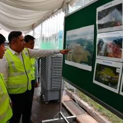 Transport Minister Anthony Loke Siew Fook and Singapore Transport Minister Khaw Boon Wan look at photos of the Rapid Transit System (RTS) construction during a visit to the proposed RTS Woodlands North site, Singapore today. - Bernama