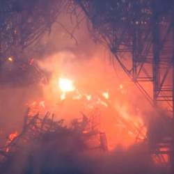 Screenshot of raging fire engulfing Notre Dame.