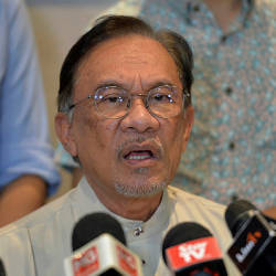 Filepix taken on June 23 shows PKR president Datuk Seri Anwar Ibrahim speaking at a press conference in the Merchant Square PKR Headquarters. — Bernama