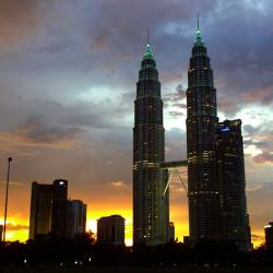 In this file photo taken on April 17, 2001, the Petronas Twin Towers, then the world's tallest buildings, crown Kuala Lumpur's skyline during dusk. Argentinian architect Cesar Pelli, designer of the towers, passed away on July 19, 2019 at the age of 92. - AFP