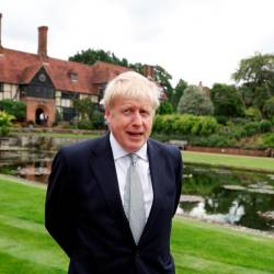 Boris Johnson, a leadership candidate for Britain's Conservative Party, looks on during his visit at Wisley Garden Centre in Surrey, Britain on June 25, 2019. — Reuters