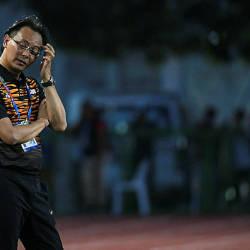 Datuk Ong Kim Swee reacts after Malaysia's loses 3 – 1 to Cambodia at the Rizal Memorial Stadium in Manila yesterday.