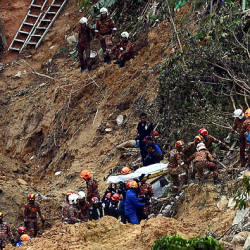 Filepix take on 22 Oct 2018, shows search and rescue personnel carrying the body of a victim of the Bukit Kukus landslide in Georgetown.