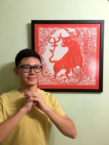 Chong with an artwork depicting the 'Year of the Ox'. – COURTESY OF CHONG KAI ZEN