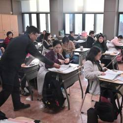 Students prepare to sit the annual college entrance exam in a classroom at a high School in Seoul on Nov 14. — AFP