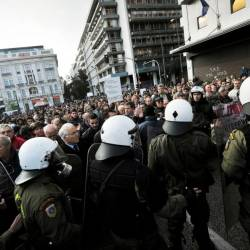 In this file photo taken on Nov 17, 2011, Greek anti-junta resistance veterans argue with police who block the road during a protest march marking the anniversary of the 1973 students uprising against military junta, in Athens. — AFP