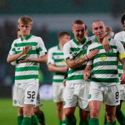 Celtic's Leigh Griffiths and Scott Brown react after the match. — Reuters