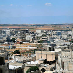 A handout picture released by the official Syrian Arab News Agency (SANA) on Aug 23, shows smoke rising in the strategic town of Khan Sheikhun after government forces took control as jihadists and allied rebels withdrew from the area. — AFP