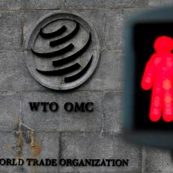 File photo shows a red light pictured at a pedestrian crossing in front of the World Trade Organization headquarters in Geneva, Switzerland, Dec 9. — Reuters