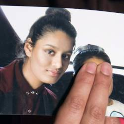 In this file photo taken on Feb 22, 2015 Renu Begum, eldest sister of missing British girl Shamima Begum, holds a picture of her sister while being interviewed by the media in central London. — AFP