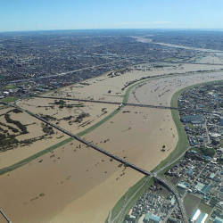 This aerial view shows the swollen Arakawa river in the aftermath of Typhoon Hagibis dividing Tokyo and Saitama prefecture on October 13, 2019. — AFP
